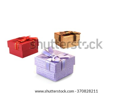 Close Up Of Three Violet, Golden And Red Gift Boxes With Ribbon And Bow, Isolated On White Background,  Horizontal Image With Copy Space, Top View - stock photo