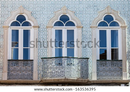 Close up of three windows and balcony in Faro, Portugal - stock photo