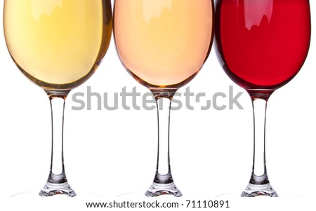 Close-up of three wineglasses. Yellow, pink and red - stock photo