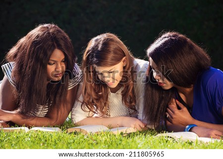 Close up of three young girls studying for exams - stock photo