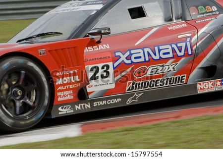 Close up of tire of Team Xanavi Nismo GT-R at Super GT Malaysia Championship 2008 - stock photo
