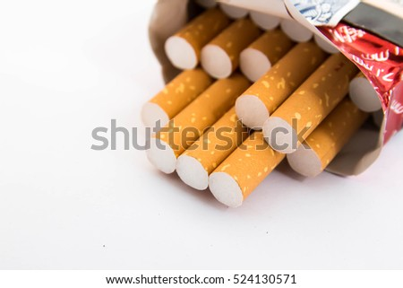 Close-up of tobacco cigarettes on white background,Unhealthy concept