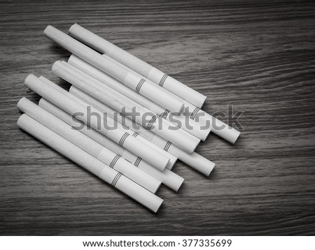 Close-up of Tobacco Cigarettes on wood,unhealthy. black and white - stock photo