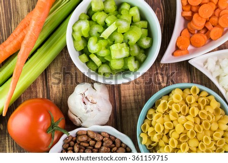 Close up of tomato, garlic and cutting vegetables - ingredients for minestrone soup. - stock photo