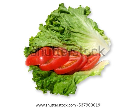Close up of tomato slices and lettuce leaves isolated on white background
