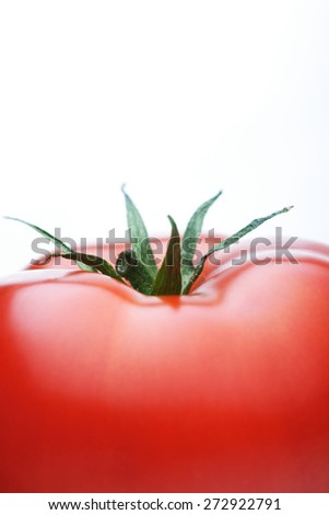 Close-up of tomatoes on white background - stock photo