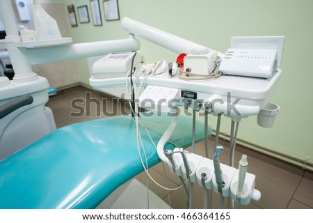 Close-up of tools for dental treatment in dentist's office. Dental unit and accessories, drills , photopolymer lamp, equipment for restorative dentistry