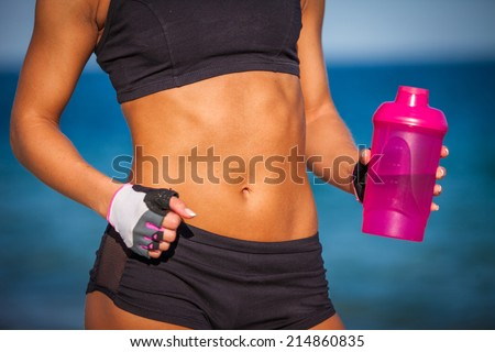 Close-up of torso of athletic fitness woman - stock photo