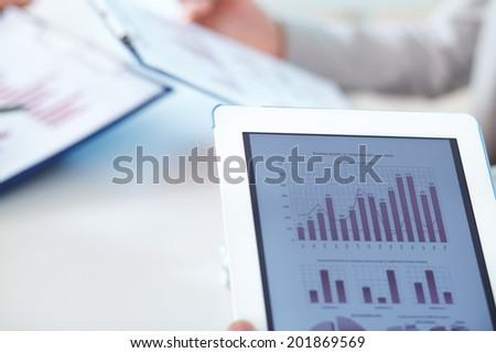 Close-up of touchpad in working environment - stock photo