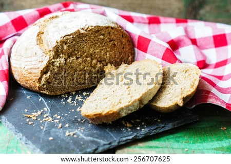 Close-up of traditional homemade bread on napkin