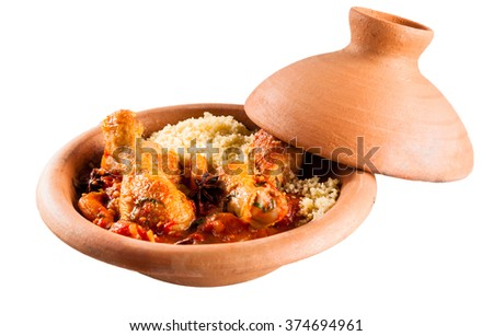Close Up of Traditional Tajine Berber Dish Made with Chicken Legs, Couscous and Savory Tomato Sauce Served in Covered Clay Pottery Dish on White Background with Copy Space - stock photo