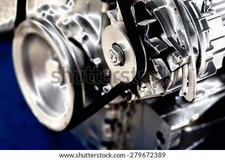Close up of transmission belt on car engine - stock photo