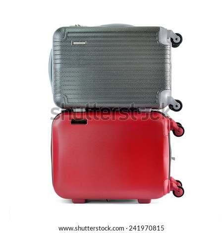 Close up of travel luggage isolated on white background, selective focus.