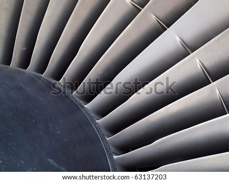Close up of turbine and blades of a jet engine. - stock photo
