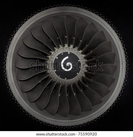 close up of turbojet of aircraft on black background - stock photo