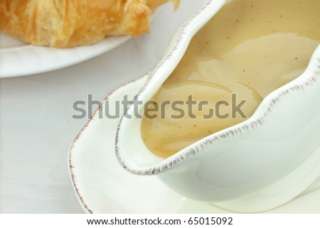Close up of turkey gravy in a gravy boat. - stock photo