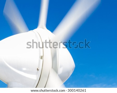 Close-up of turning blades of marine wind generator - eco-friendly energy for yachts - stock photo