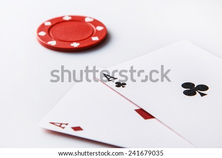 Close up of two aces and chip - stock photo