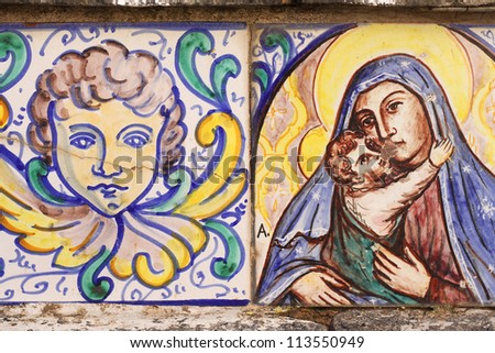 Close up of two antique tiles of angel and madonna, from Sicily, Italy