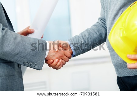 Close-up of two architect?s hands shaking - stock photo