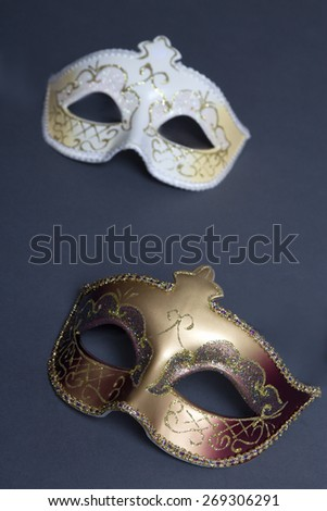 close up of two beautiful carnival masks on grey background - stock photo