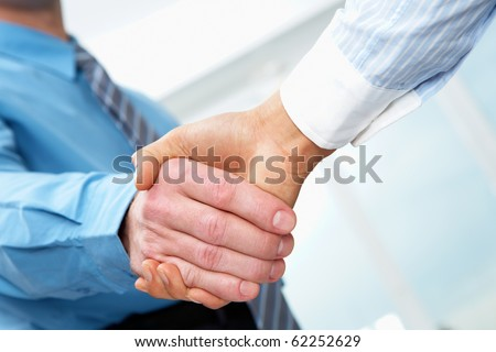 Close-up of two businessmen hands shaking - stock photo