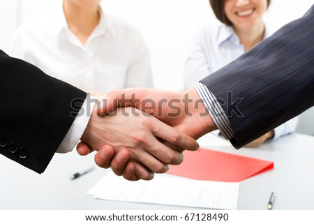 Close-up of two businessmen?s handshake