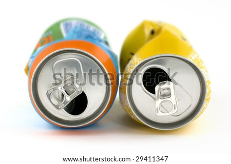 Close up of two crushed cans on white background. Shallow depth of field. - stock photo