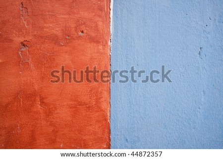 Close up of two different painted walls coming together in Antigua, Guatemala. - stock photo