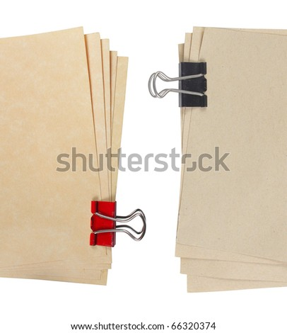 close up of two different types of paper attached with a paper clip - stock photo