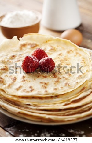 close up of two french style crepes, shallow dof. Some ingredients in the background - stock photo