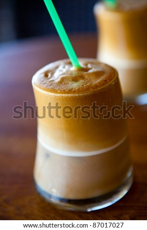 Close-up of two glasses of refreshing ice coffee - stock photo