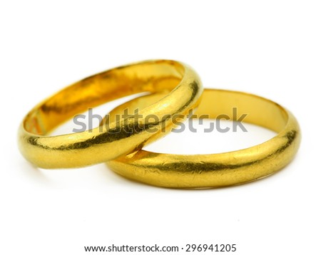 close up of Two gold rings on white background, ring for wedding as commitment concept.