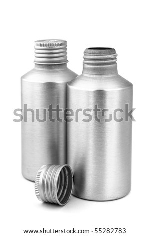 Close Up Of Two Grey Metal Bottles Isolated - stock photo