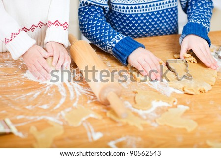 Close up of two kids baking cookies - stock photo