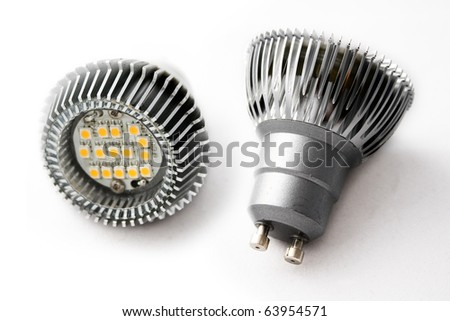 Close-up of two LED light bulbs against a white background. - stock photo