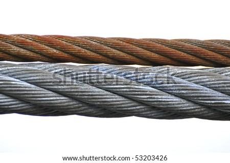 Close up of two metal cables on a pulley system on large crane - stock photo