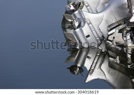Close up of two outboard boat motors and propellers - stock photo