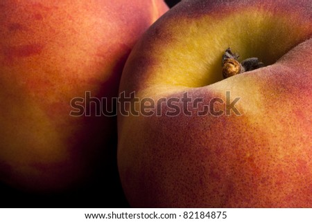 Close up of two peaches