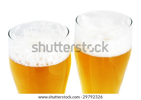 close up of two pints of beer - stock photo