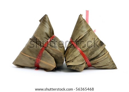 Close up of two rice dumplings over white background. - stock photo