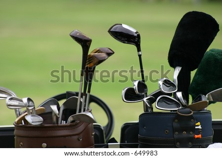Close up of two sets of golf clubs