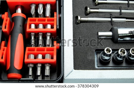 Close up of two sets of tool, screwdriver with adjustable torque in tool box. - stock photo