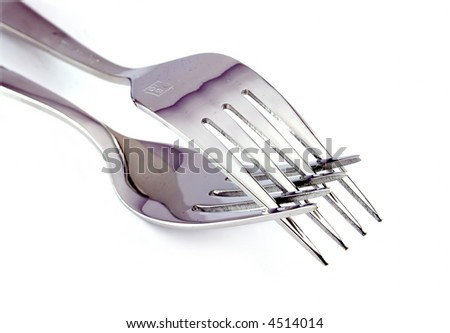close-up of two silver forks isolated on white - stock photo