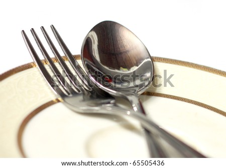 Close up of two spoons on a plate - stock photo