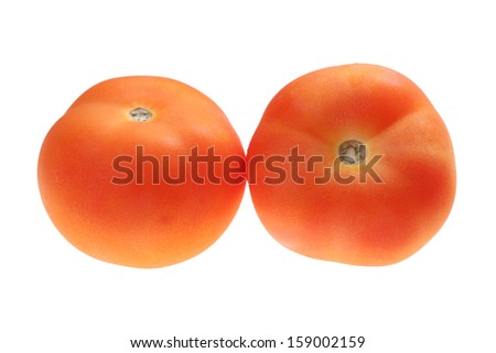 Close up of two tomatoes isolated on white background. - stock photo