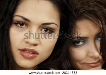 Close-up of two young brunette friends