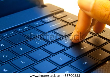 Close-up of typing male hands.
