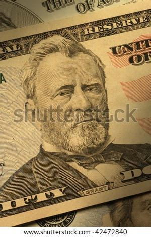 Close-up of Ulysses S. Grant on the $50 bill, dramatically lit. - stock photo