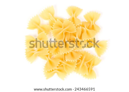 Close up of uncooked farfalle pasta against white background - stock photo